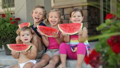 Portrait of kids with watermelon, dolly shot Stock Footage