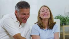 Mature couple using laptop computer Stock Footage