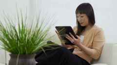 Portrait of Asian woman with digital tablet Stock Footage