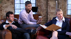 Group of young professional business people in relaxed discussion. Small - stock footage