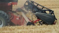 Combine harvesting wheat on farm Stock Footage