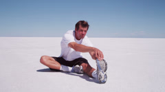 Athlete stretching at salt flats - stock footage