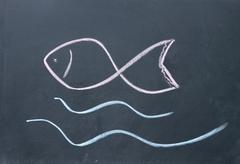 Fish sign drawn with chalk on blackboard Stock Photos