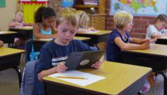 Elementary school student uses a digital tablet Stock Footage