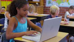 Portrait of elementary school student with laptop computer - stock footage