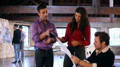 Small Business.  Casual downtown workers in chic loft or warehouse offices. - stock footage