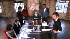 Creative small business boardroom. Casual young downtown workers in chic loft or Stock Footage