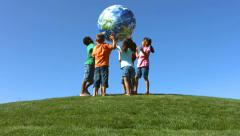 Portrait of children of various ethnicities on a hilltop Stock Footage