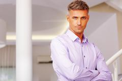 Portrait of businessman standing in hall Stock Photos