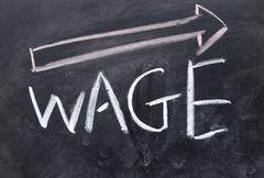 increase wage sign drawn with chalk on blackboard - stock photo