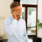 mature happy caucasian man on phone - stock photo