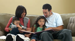 Family reading a book together Stock Footage