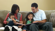 Stock Video Footage of Family reading a book together