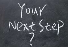Your next step   title written with chalk on blackboard Stock Photos