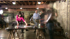 Small business people.  Casual young downtown workers in chic loft or warehouse - stock footage
