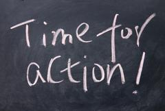 Time for action title written with chalk on blackboard Stock Photos