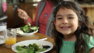 Stock Video Footage of Portrait of girl sitting at dinner table with family