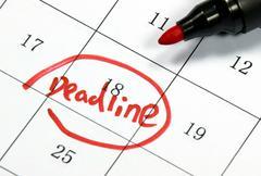 Stock Illustration of deadline sign written with pen on paper