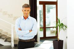 portrait of a confident handsome mature man - stock photo