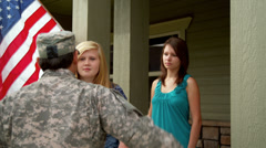 Mother and daughter say goodbye to soldier Stock Footage