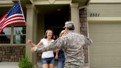 Family runs out to greet soldier - stock footage