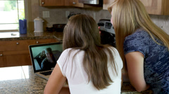 Teen daughters video chat with military father Stock Footage