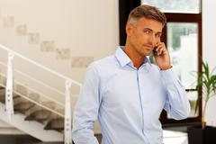 mature happy caucasian man on phone - stock photo