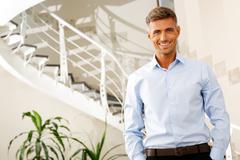portrait of a confident handsome mature man - stock photo