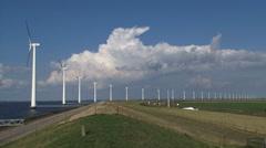 Offshore wind farm and highway along dike + pan Lake IJsselmeer Stock Footage