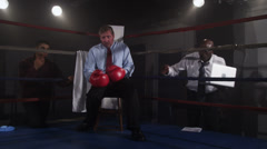 Stressed out businessman working in boxing ring Stock Footage