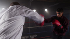 Businessmen boxing in ring Stock Footage
