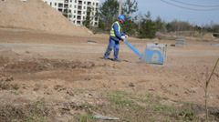 Worker in blue workwear  at construction site Stock Footage