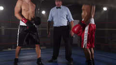 Referee starts boxing match - stock footage