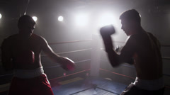 Boxers fight in boxing ring - stock footage