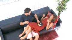 Overhead shot of attractive young couple with modern lifestyle relaxing together Stock Footage