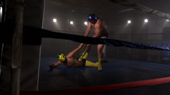 Masked wrestler attempts to tap out - stock footage