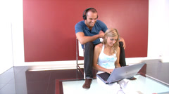Attractive young couple listening to music online. High quality HD video - stock footage