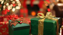 Christmas presents in front of tree, dolly movement - stock footage