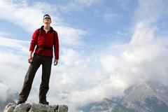 Mountaineer on mountain top in the mountains Stock Photos