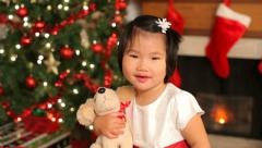 Portrait of young girl holding toy at Christmas Stock Footage