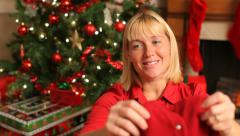 Woman opens a Christmas gift Stock Footage