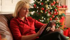 Woman using a digital tablet at Christmas Stock Footage