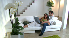 Couple with nice lifestyle spending time together and relaxing in their Stock Footage