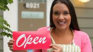 Stock Video Footage of Portrait of small business owner holding OPEN sign