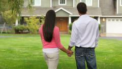 Couple stand looking at home - stock footage