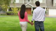 Stock Video Footage of Couple stand looking at home