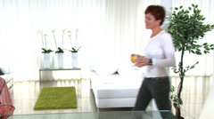 Wild young woman rocking out as she plays the guitar in her contemporary home. Stock Footage