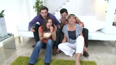 Group of friends with nice lifestyle socialising together and watching sports on Stock Footage