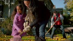 Happy mixed race family playing in autumn leaves - stock footage