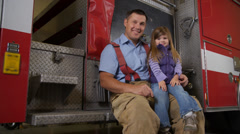 Portrait of firefighter and his daughter - stock footage